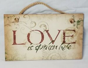 """Highland Graphics Wall sign """"Love is spoken here"""" -- Item # 41-000"""