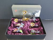 7 STUNNING GLASS AND ENAMEL BOXED NAPKIN RINGS