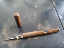Vintage Metal Sewing Needle Case Holder Container with some needles.