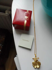 Women's Risis of Singapore 22carat gold plated real orchid pendant and chain.