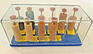 Moore's Spindle Stand with Assortment Of Brass Center Discs