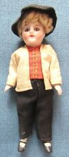 Vintage bisque boy doll in traditional European dress; movable arms & legs (3)