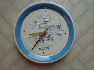 """LAND O LAKES FEED 10""""D BLUE/WHITE STONEWARE BATTERY WALL CLOCK - WORKS GREAT!"""
