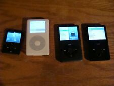lot of four apple ipods (classic, nano, 120 gb, 40 gb, 7th gen, etc.)