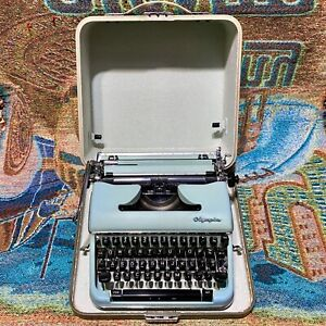 Vintage Blue Olympia Deluxe SM4 Portable Typewriter with the Case - Works Great