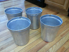 An Interesting Set of 4 Aluminum Sap Buckets Great for Flower Pots or To Use