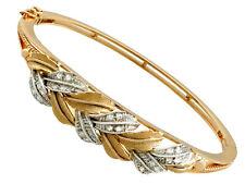 Contemporary 0.48 ct Diamond 18Carat Yellow Gold 18Carat White Gold Set Bangle