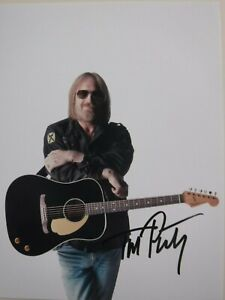 TOM PETTY (deceased) SIGNED PHOTO w/GUITAR