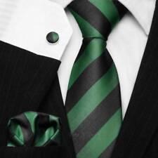 Corbatas, pajaritas y pañuelos de hombre a rayas en negro