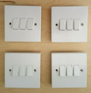 Four new in Total 3 Gang 2 Way White Light Switches 6 amp 240 volt rating