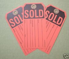 500 larg red sold tags w center slit, heavy duty paper merchandise auction sale