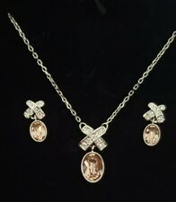Authentic new Swarovski Jewelry Set Pendant Peach X and O Necklace and Earrings