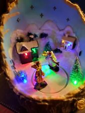 Pac - Asian Creations Limited - Lighted/Animated Skaters on a Tree Stump