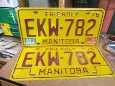 1976 MANITOBA CANADA MATCH PAIR LICENSE PLATE SET VEHICLE TAX TAG AUTOMOBILE