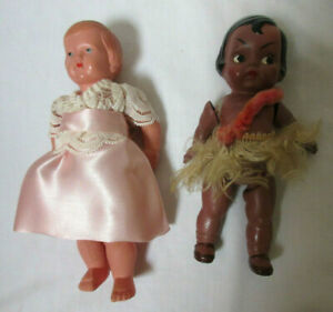 2 Vintage Germany Celluloid Dolls - One Hawaiian, one Dressed Girl