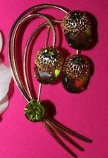 POPULAR SARAH COVENTRY SIGNED 3 1/4 INCH PIN WITH PERIDOT COLORED STONES