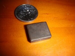 A small piece of vintage rectangular magnet