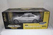 1-18 Silver Pontiac GTO Coupe 2004 Diecast Replica by ERTL item #33727sealed box