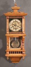 """German wall clock in a pine and walnut case, c.1900, 9"""" wide, 25"""" high Lot 375"""