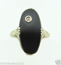 14K WHITE GOLD FILLED FILIGREE BLACK ONYX RING WITH A SMALL DIAMOND.