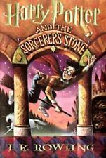 Harry Potter and the Sorcerer's Stone by J. K. Rowling, paperback book, novel.