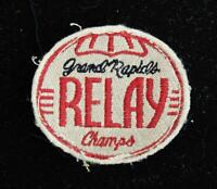 """VINTAGE 1960'S-1970'S RELAY CHAMPION BLACK, RED, AND WHITE PATCH 3"""" X 2 1/2"""""""