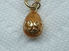 Joan Rivers 1997 ANNUAL goldtone on yellow and gold enamel egg with extender