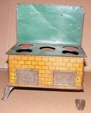 Vintage Tin Toy Stove with Embossed Doors (damaged foot)