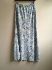 Long floral women skirt size small. Label is missing, brand is not known