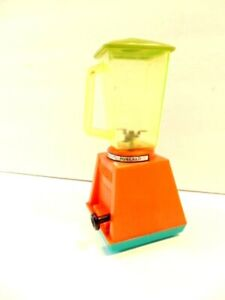 circa 1960's orange and green plastic friction toy food blender
