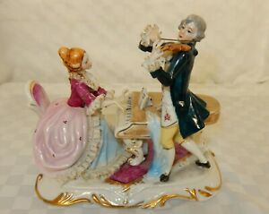 Continental Porcelain Figurine of a Musical Couple with Ceramic Lace Detail
