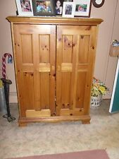 Hooker Television Cabinet, pine, excellent condition. Non-smoke, non-pet house.