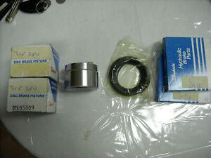 Set of 2 Raybestos disc brake pistons DPS 85009 & WK523 seal kits 70's Cadillacs