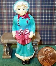 About 1/24'' scale resin sitting lady with hat box 2 3/8'' tall