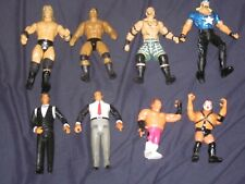8 WWE WCW ACTION FIGURES - THE ROCK TRIPLE H HULK HOGAN BRUTUS BEEFCAKE DROZ