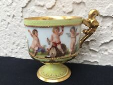 ANTIQUE HAND PAINTED DRESDEN FOOTED CUP W/ CHERUBS & PEGASUS HANDLE