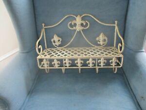 Vintage metal shelf. Hooks on the bottom.. Fleur de lis