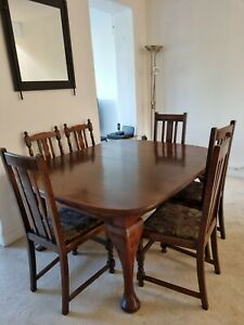 Mahogany extending dining room table and 8 chairs - preowned