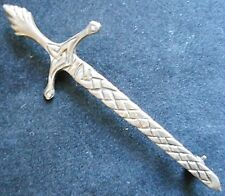 Silver brooch in the form of a claymore. Hallmarked