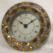 """Quartz Round 4.25"""" Clock - Jeweled with gold jewels on silver metal back"""
