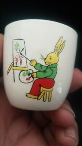 MINT CONDITION 1940,S EGG CUP WITH A RABBIT PAINTING CARROTS {PETER RABBIT} ??