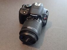 CANON EOS REBEL SL1 (100D) WITH EF-S 18-55 IS STM KIT, CHARGER, AND BATTERIES