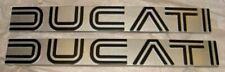 1974-1979 Ducati 860GT NOS pair gas fuel tank side cover emblem badges silver