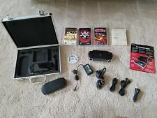 SONY PSP-1001 game console, 3 games, metal carrying case, additional software