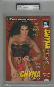 Chyna Encapsulated WWF VHS Fitnes Cover PSA/DNA Cert. Auto PSA 6 and VHS tape