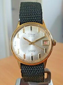 Vintage Felicia Deluxe GP, silver dial Swiss made watch 17j wind. Runs fast.