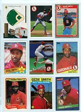 OZZIE SMITH -- 9 DIFFERENT YEAR/MANUFACTURE CARDS IN AN ULTRA PRO SHEET
