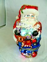 "SANTA W/TOYS  TEA LIGHT ORNAMENT GLASS VERY COLORFUL SHINY  APPROX. 6 1/2"" TALL"