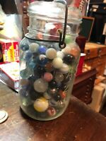 ANTIQUE ATLAS WIRE BAIL JAR FULL of VINTAGE MARBLES AND SHOOTERS SIZES COLORS