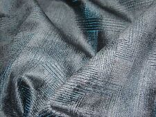 A LUXURY DARK BLUE UPHOLSTERY FABRIC IN A VELOUR WITH A SUBTLE GEOMETRIC DESIGN.